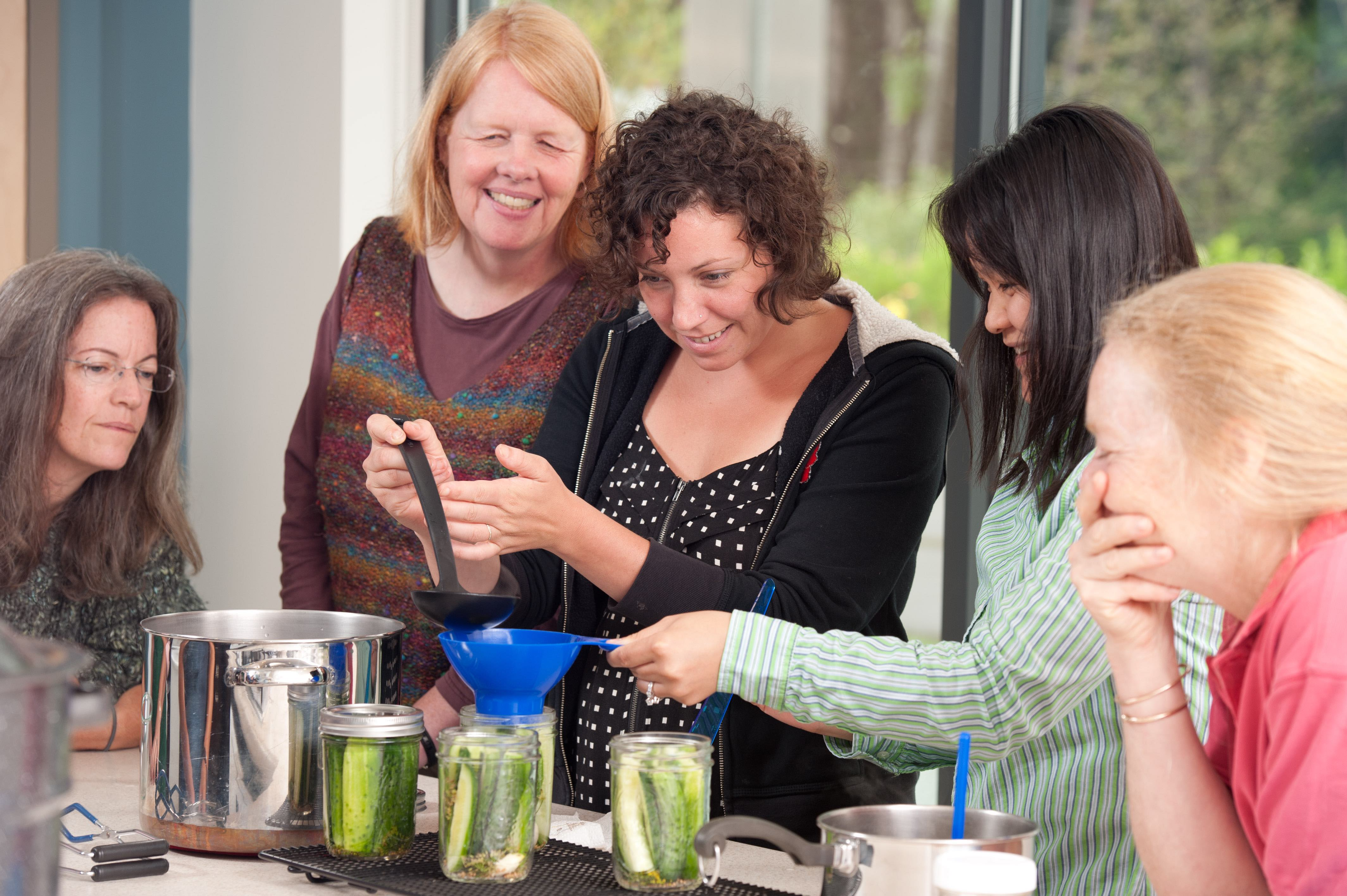 image of 5 women making pickles