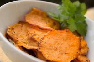 Sweet potato chips in a dish with garnish