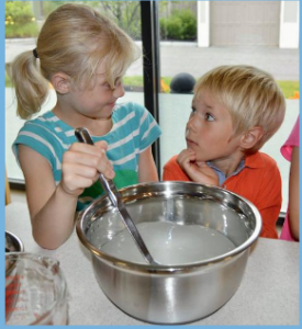 Two Children stirring a mixing bowl