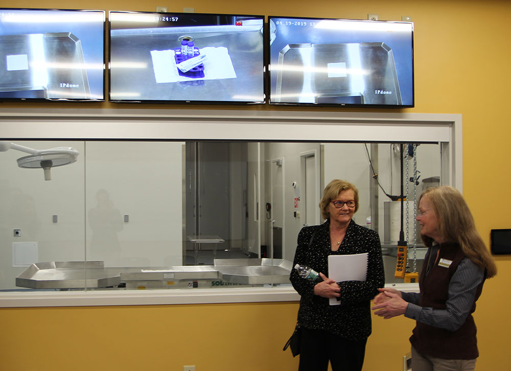 Congresswoman Chellie Pingree talks with Dr. Anne Lichtenwalner, Extension Veterinarian, Director of the UMaine Veterinary Diagnostic Lab, and an Associate Professor, in the Viewing Room for the Veterinary Diagnostic Lab's Necropsy Suite.