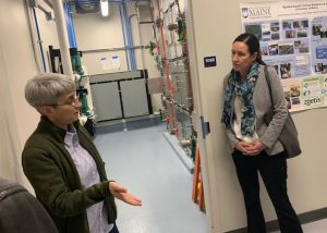 Dr. Deborah Bouchard (left) and Commissioner Amanda Beal, Department of Agriculture, Conservation and Forestry (right), talk in the UMaine Extension Diagnostic and Research Lab.