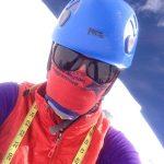 Kit Hamley wearing sun glasses, helmet, and scarf