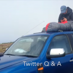 Kit Hamley atop her Range Rover tweeting from the field