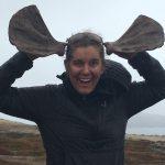 Kit Hamlin holds sea lion scapula bones up to her head to mimic moose antlers.