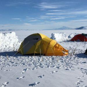 tent and snow windbreak on Antarctic ice sheet