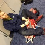 Charles Rodda waits for the plane to take the team to Peru.