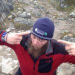 Charles Rodda wearing a UMaine Cooperative Extension hat at Salkantay Pass.