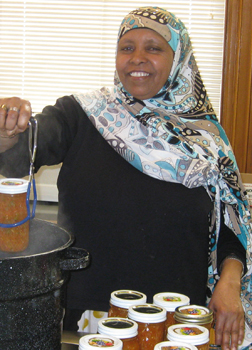 woman participates in a hands-on canning class