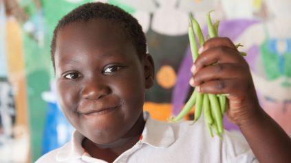boy holding green beans
