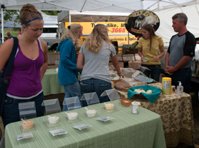 samples on a table at a farmers market; photo by Edwin Remsberg, USDA