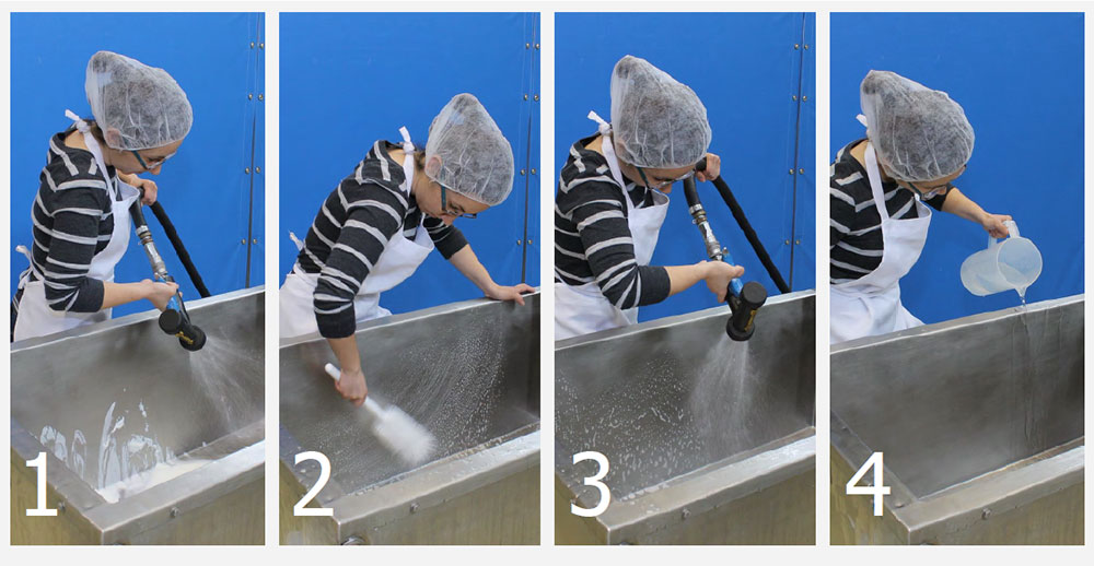 cheesemaker demonstrating the 4 steps to cleaning/sanitizing the cheese vat: rinsing, scrubbing with soap and a brush; rinsing off soap; and sanitizing with bleach
