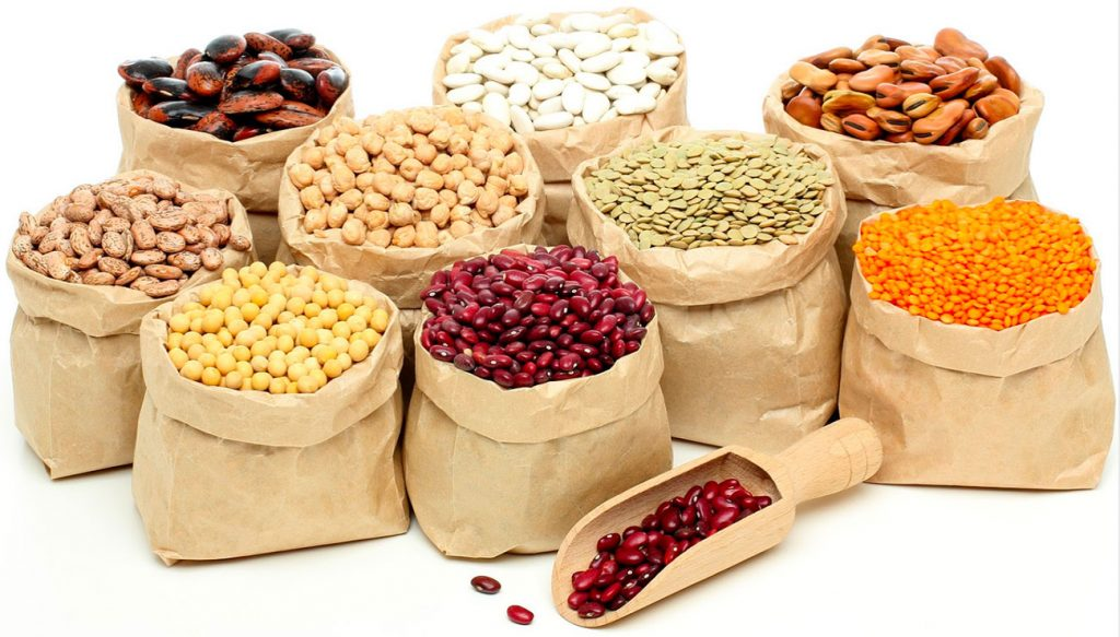 assorted dried beans, peas and lentils in sacks