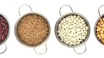 Variety of legumes in cooking pots