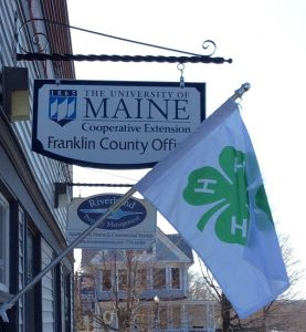 4-H flag hanging outside the UMaine Extension Franklin County office