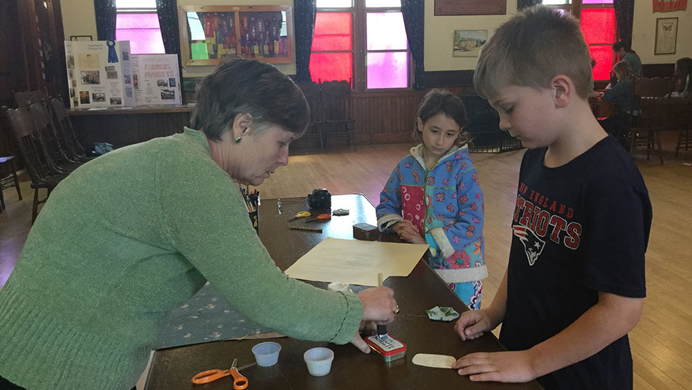 4-H leader and 4-Hers working on a project