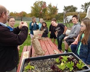 David Fuller teaching youth about food production