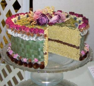 layer cake with edible blossom decorations
