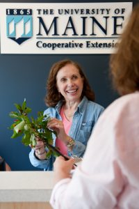 Extension experts identifies a plant sample for a client; photo by Edwin Remsberg