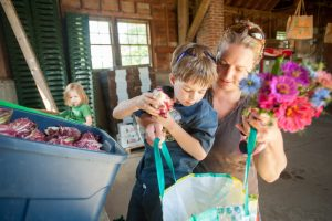 Mother and son shopping at a local farm; photo by Edwin Remsberg