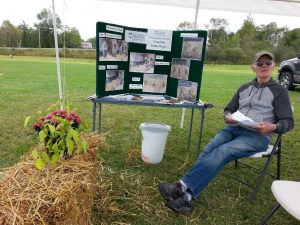 John Beraud, Maine Master Gardener Volunteer with a display about straw bale gardening