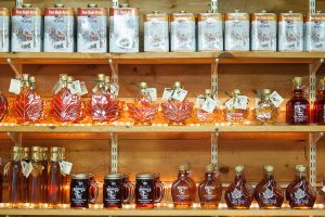 Maine maple syrup products for sale on shelves of sugar house