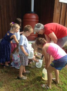 Kids learning about rain barrels with Mim