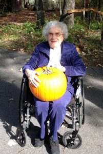 Senior with a large pumpkin
