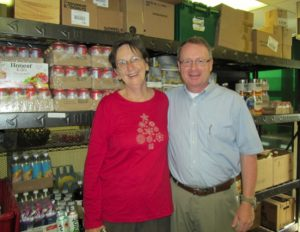North Berwick Food Pantry Volunteer Mary Craig (left) with Pastor Tim Kezar (right) at the grand opening of the new site for the North Berwick Food Pantry.
