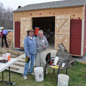 Tom Settlemire Community Gardens committee members Judy Renolds and Bonnie Studdiford pose in front of shed