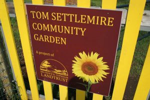sign for the Tom Settlemire Community Gardens