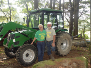 Anna and Bill Spiller standing by a tractor