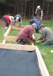 People building raised flower bed.