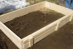 Framing a raised-bed. Raised-bed gardens can solve poor soil and drainage problems.