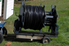 In the offseason, after drip irrigation lines have been cleaned, and any leaks or bad emitters are repaired, they are stored on this large reel, attached to a small trailer, pulled behind a garden tractor.