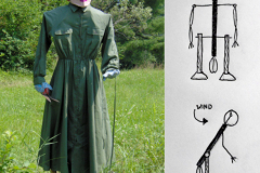 This creative scarecrow is made of wood, pipe, wire, and weights, and dressed fashionably in a green dress and floral hat. Pivot points create movement.