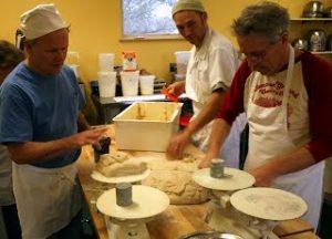 Jeffrey Hamelman, Randy George, and Jim Amaral (L to R) divide the dough.