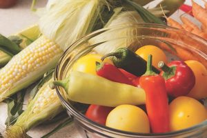 corn and bowl of chilis and tomatoes