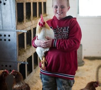 4-H Youth holding laying hen