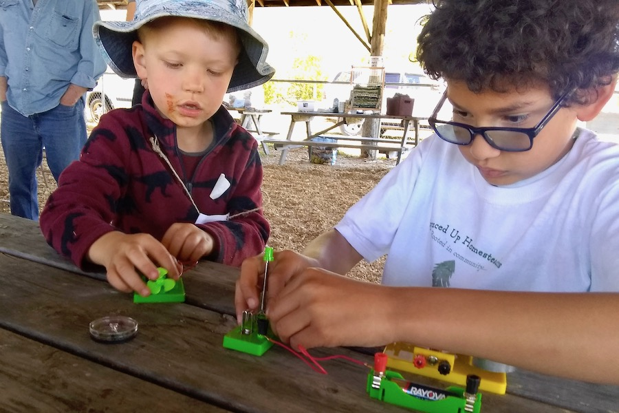 Two 4-H'ers experimenting with Batteries at the June Jamboree