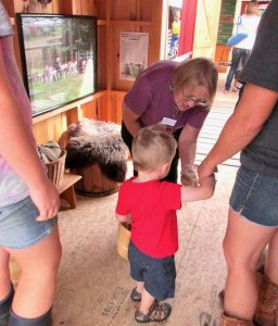 Adults and youth experiencing 4-H Farm-to-Fair, an interactive exhibit at the Union Fair