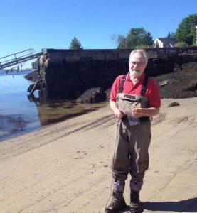 Dave Lewis on a beach