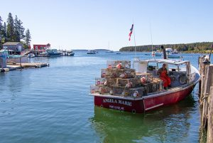lobster fisherman on his boat in Port Clyde, Me