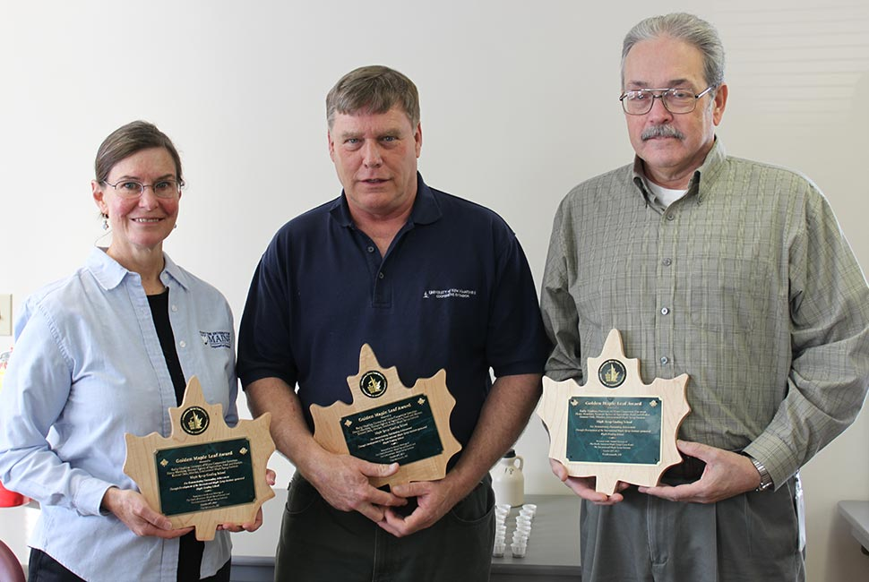 Three staff with awards