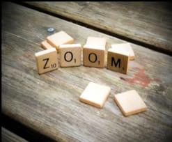 Scrabble tiles that spell ZOOM