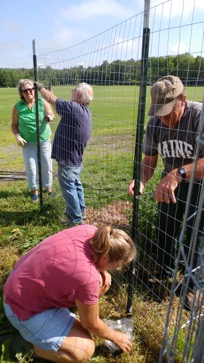 Piscataquis Executive Committee put up fence at school garden