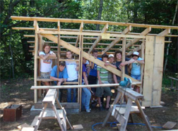 Volunteers building a shed at the UMaine 4-H Camp & learning Center at Tanglewood