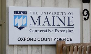 """The University of Maine Cooperative Extension Oxford County Office"" building sign"
