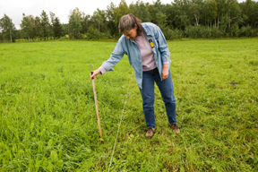 woman inspects pasture land; photo by Edwin remsberg, USDA