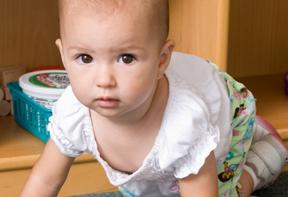 worried looking baby; photo by Edwin Remsberg, USDA
