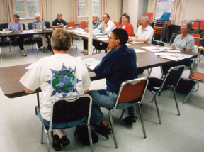 group of people sitting around a table